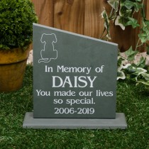 Large green slate headstone with a plinth