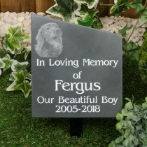 Large black slate memorial plaque on a metal stake