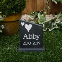 Small black slate headstone with a plinth
