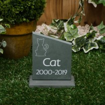 Small green slate headstone with a plinth