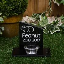 Small black granite headstone with a glass tea light holder