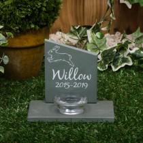 Small green slate headstone with a glass tea light holder