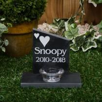 Small black slate headstone with a glass tea light holder